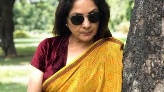Neena Gupta in yellow saree and maroon blouse shows how to do autumn dressing right