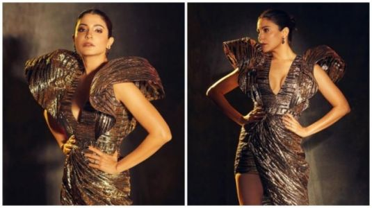 Anushka Sharma in metallic gown with puffed sleeves is fierce and sexy. See pics