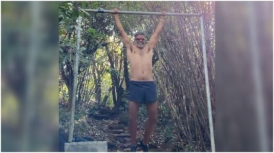 Milind Soman does bar pull-ups during outdoor workout session. New video