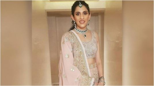 Shloka Mehta is ethereal in pink and gold lehenga choli for family wedding. All pics