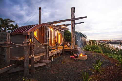A fishing boat-turned-tiny house gets a new life on the shores of the Whanganui River