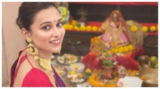 Mimi Chakraborty in purple saree and gold jewellery is at her traditional best for Lakshmi Puja celebrations