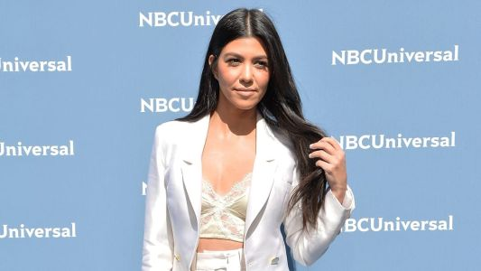 Great Outfits in Fashion History: Kourtney Kardashian in a White Sergio Hudson Suit