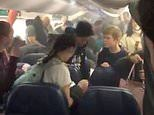Passengers are forced to evacuate a Delta Air Lines plane after smoke started to fill the cabin