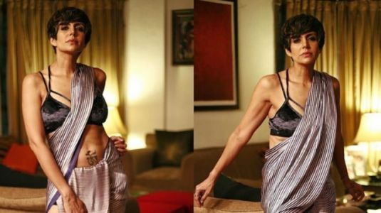 Mandira Bedi gives Rs 28k silk saree a modern twist with bralette and boots. We are swooning
