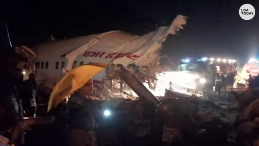 Air India Express flight crash: plane skids off runway leaving at least 16 dead