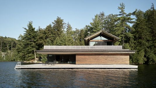 The Metrick Cottage and Boathouse Illuminates Warmth and Elegance All Year-Round