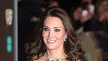 Duchess Kate glows in green at the BAFTAs while the stars wear black